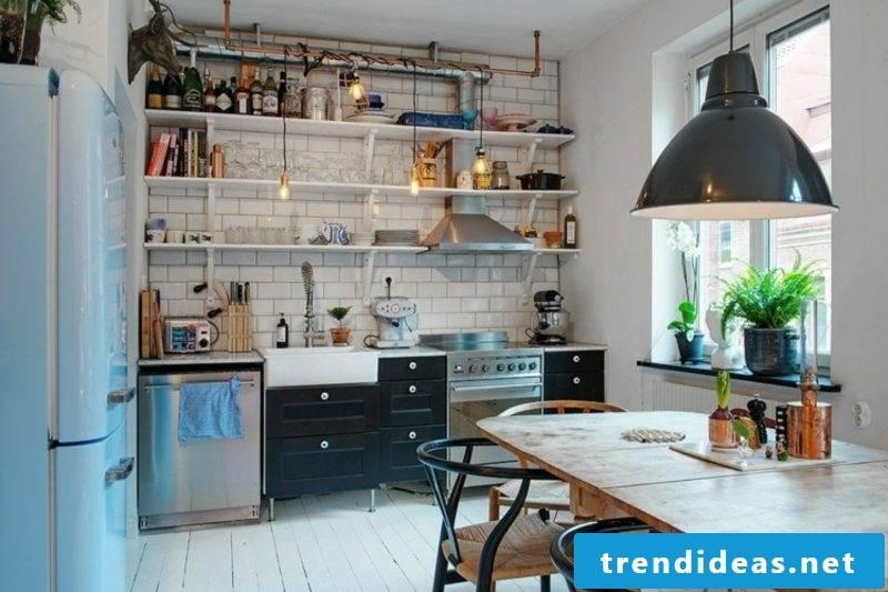 Scandinavian living black drawers kitchen shelves tiles