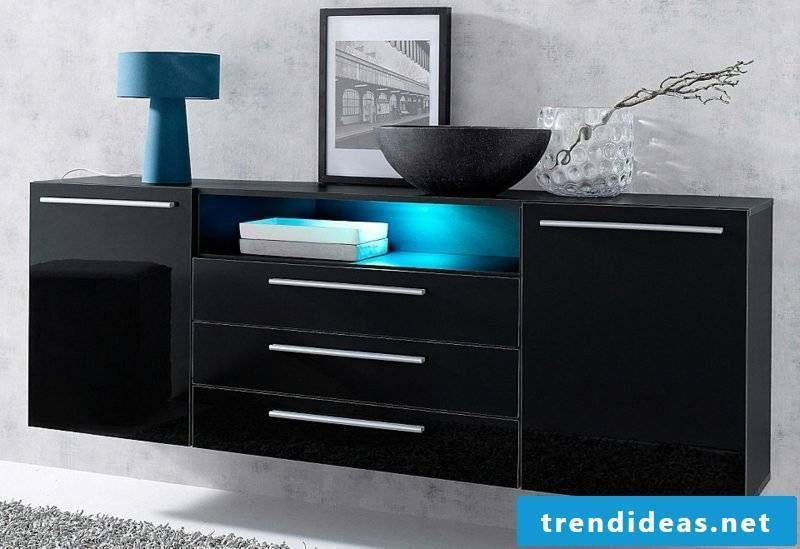 Sideboard hanging black eye catcher in the interior