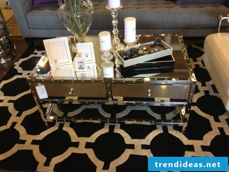 Silver table with charming design.
