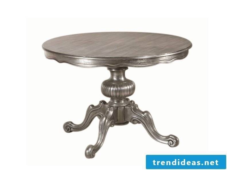 Design the apartment with a small silver table.