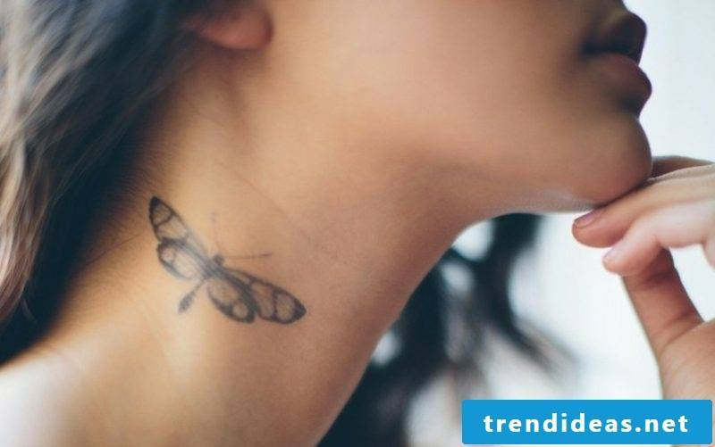 small tattoos motifs moth on the neck woman