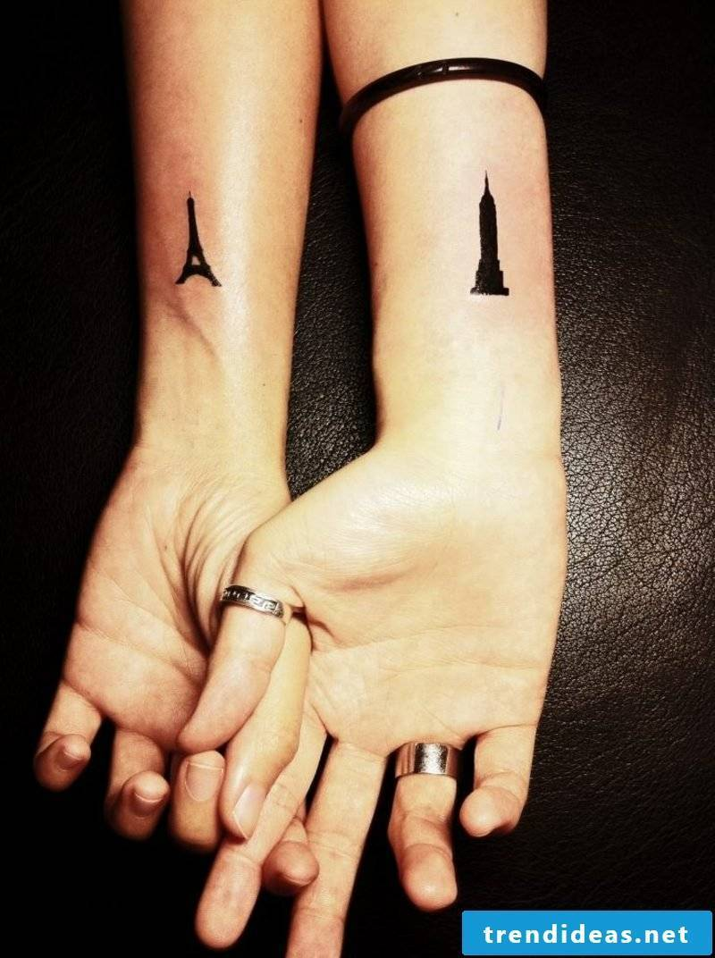small tattoos motifs forearm Eiffeltower and Empire state building