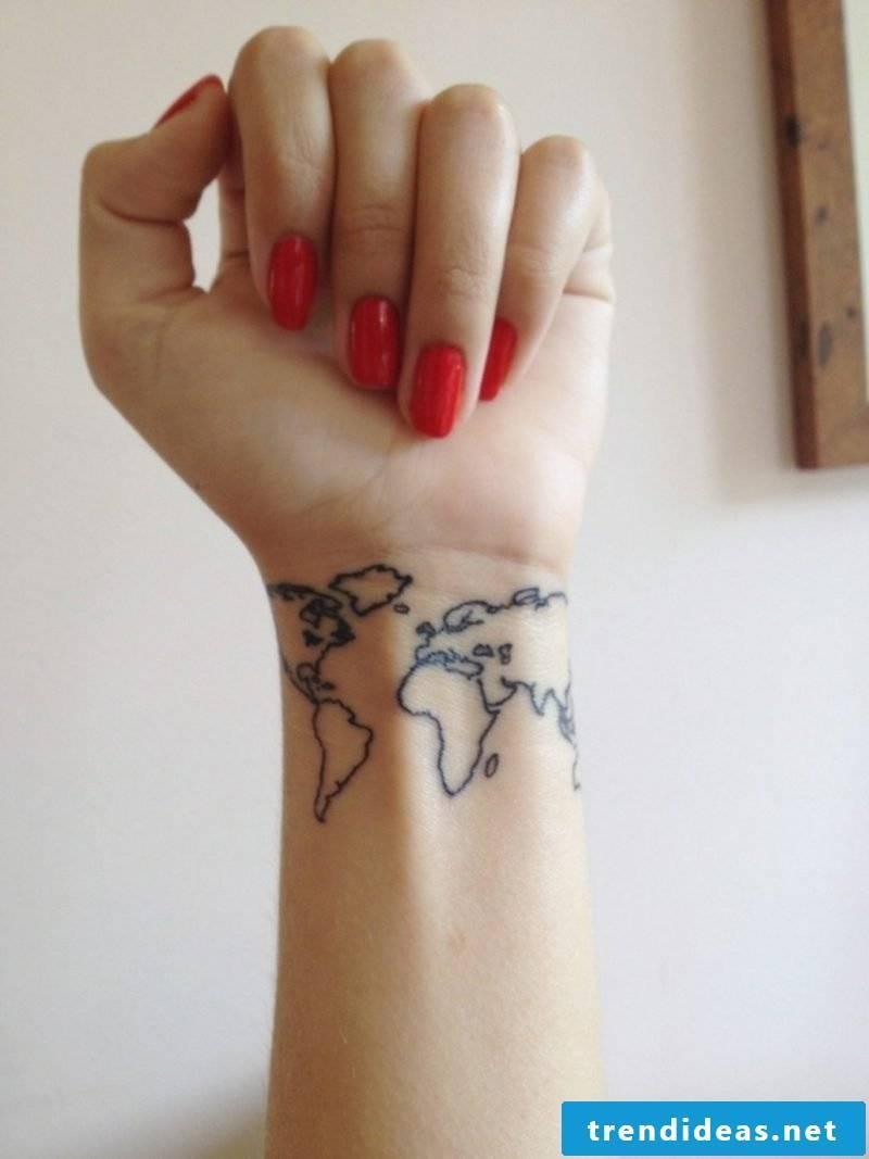 small tattoos motifs world map wrist woman