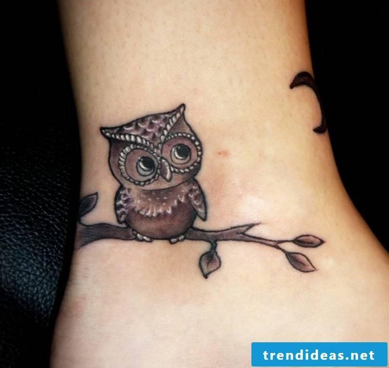 small tattoo motifs owl ankle
