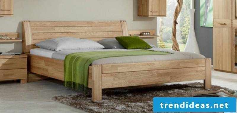massive wooden double bed