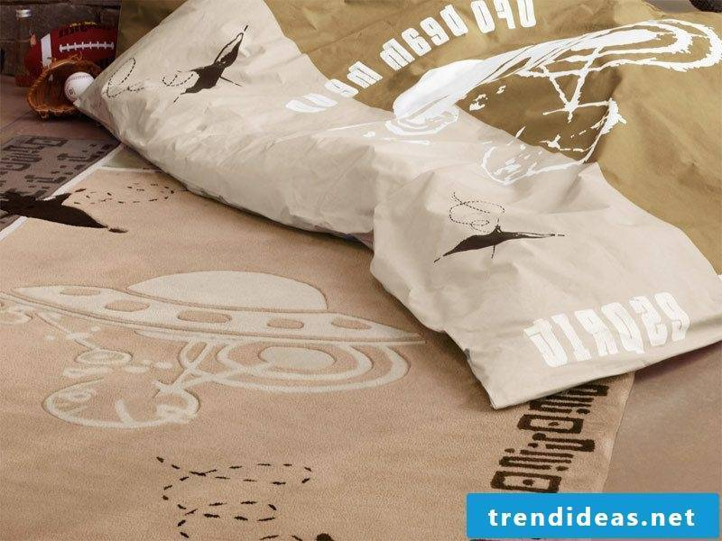 Combine the bed linen with the nursery carpet