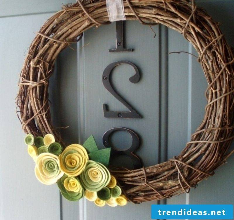 Spring tinker wreath decorated with plastic flowers
