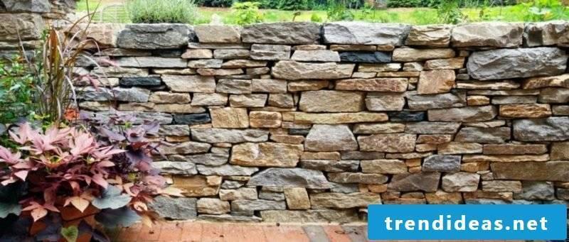 original stone wall in the garden eye catcher