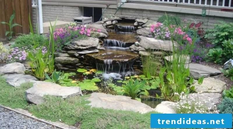 Garden pond bordering wall as a natural stone