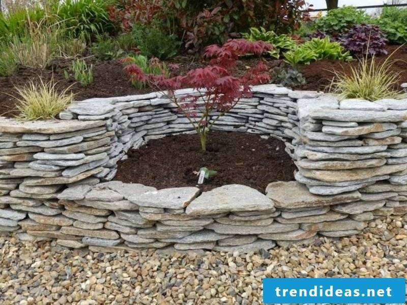 Stone wall in the garden sitting area
