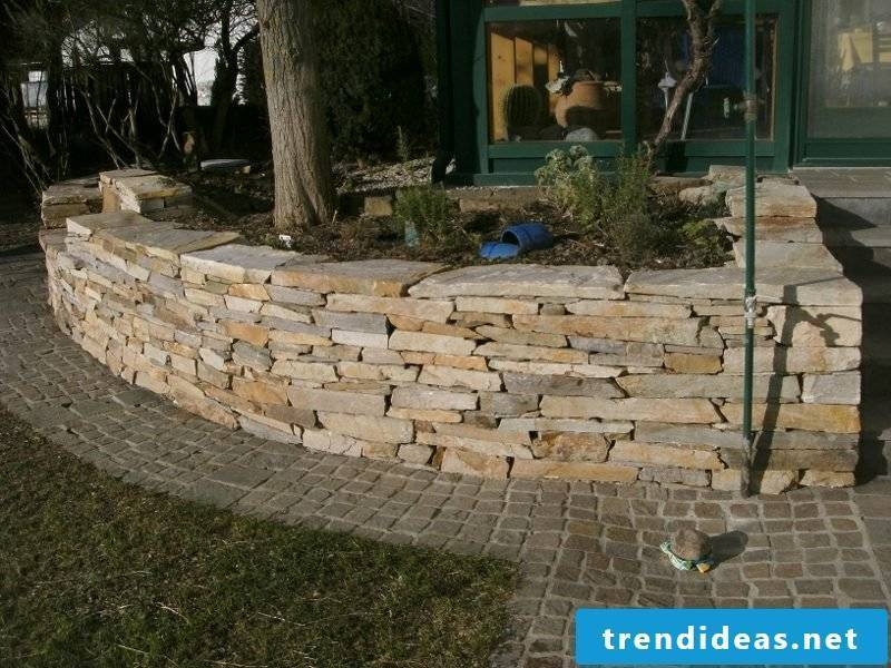 Stone wall in the garden smaller stones