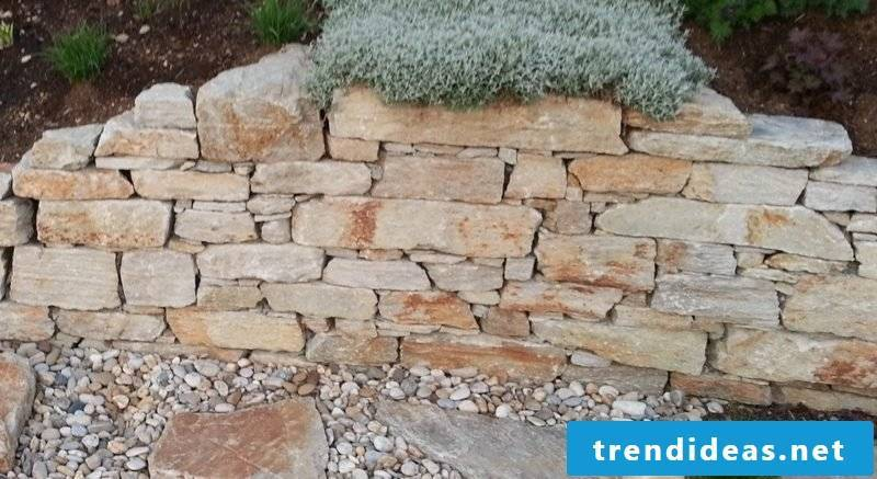 decorative stone wall in the garden natural stone