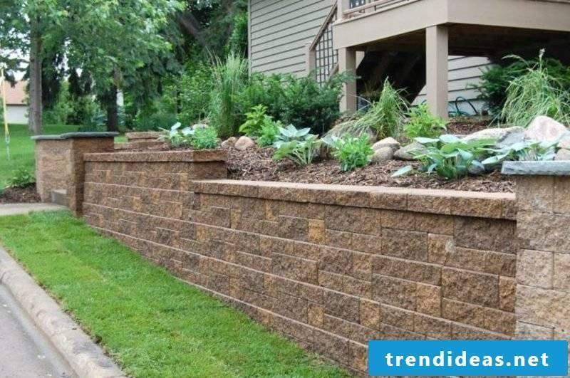Stone wall in the garden apron border