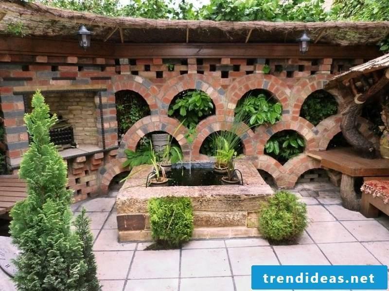 original garden wall of brick planted