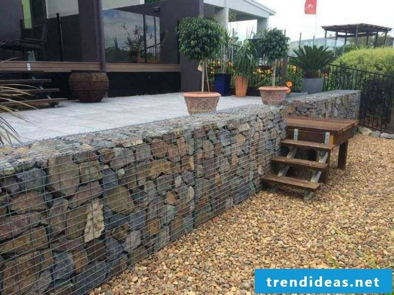 Gabion fence made of natural stone low