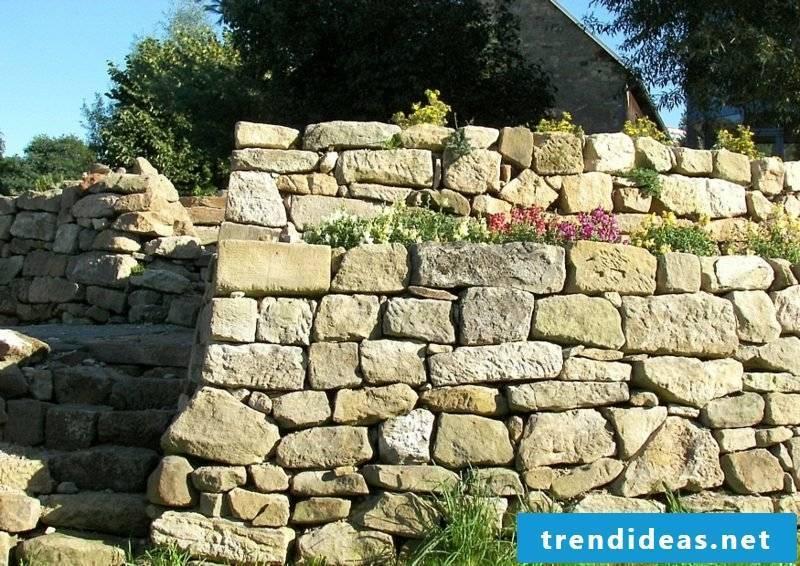 Stone wall in g garden gradually built