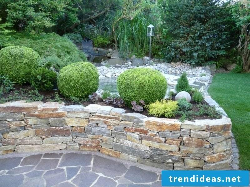 low stone wall as a beet border garden