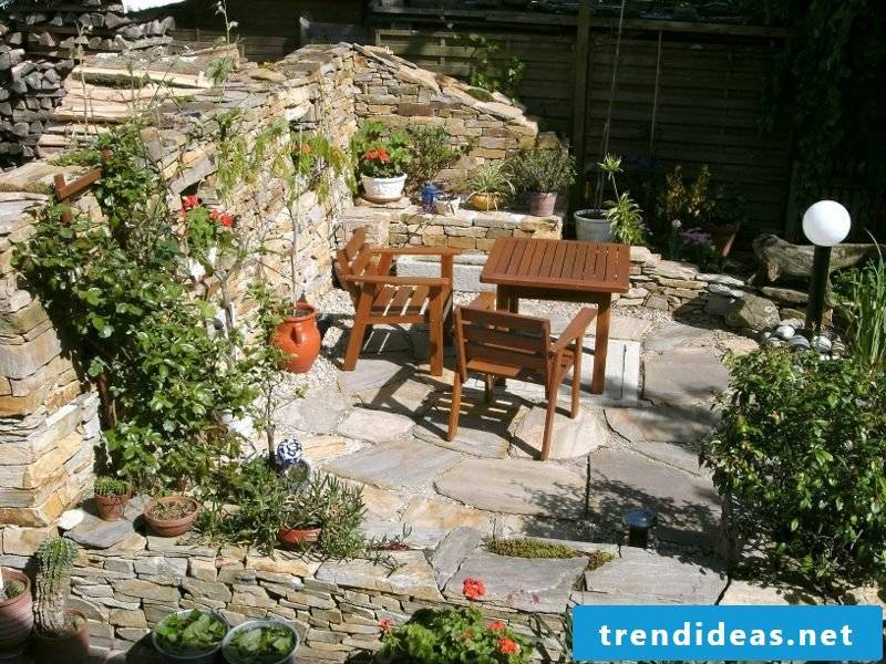 Stone wall in the garden. Screening on the terrace
