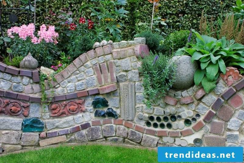 Stone wall in the garden unusual look different stone types
