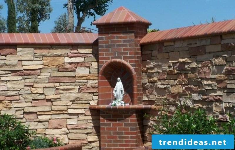 decorative stone wall in the garden eye catcher and privacy screen