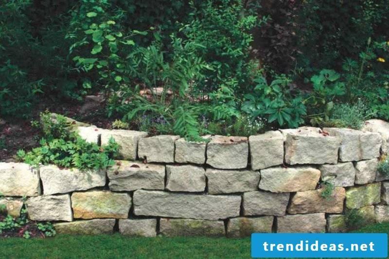 beautiful stone wall garden bed border