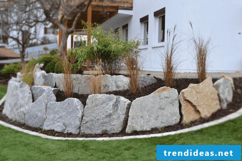 low garden wall of solid stones