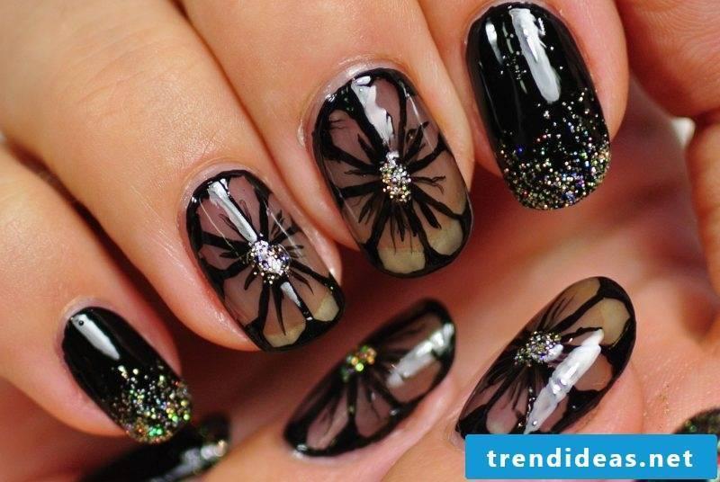 Nail art design black glitter and flowers