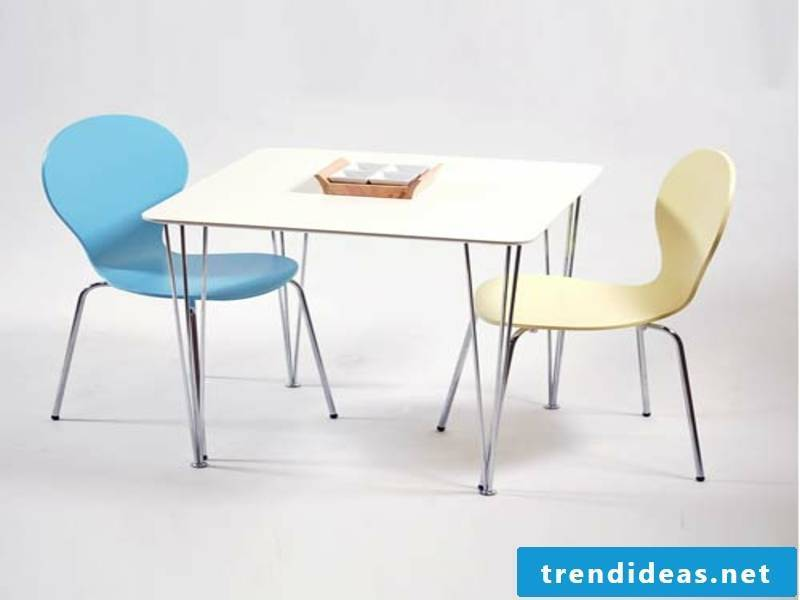 kitchen table and two colored chairs