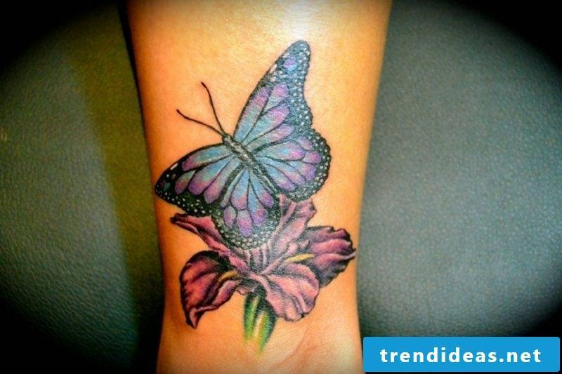 Tattoo butterfly with flower