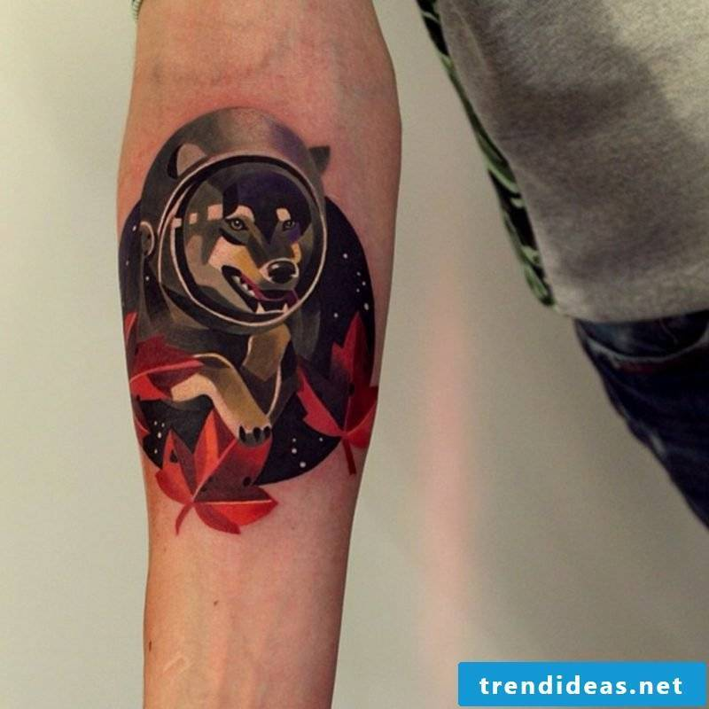 Tattoo on forearm man wolf interesting design colored