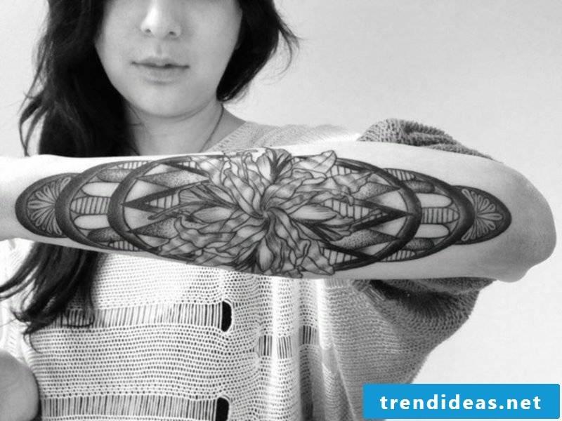 original tattoo on forearm woman geometric motifs 3d effect