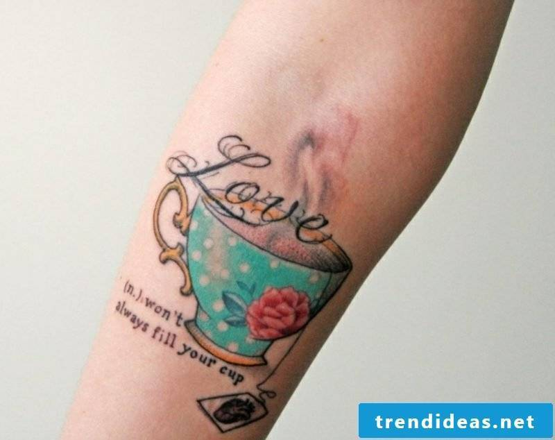 Tattoo on forearm teacup colored woman