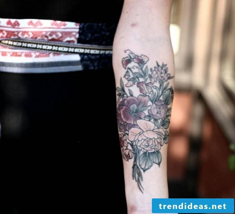 Tattoo on forearm. Bouquet of creative ideas. Women