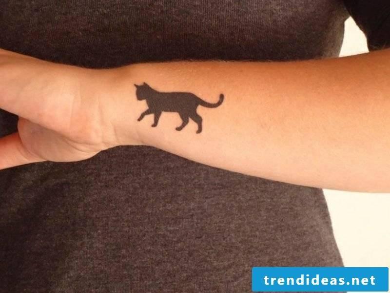 Tattoo on forearm woman black cat