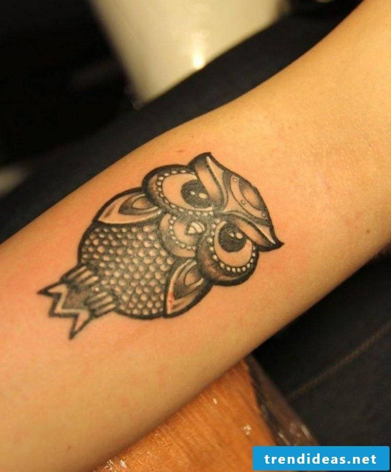 Tattoo on forearm woman owl small