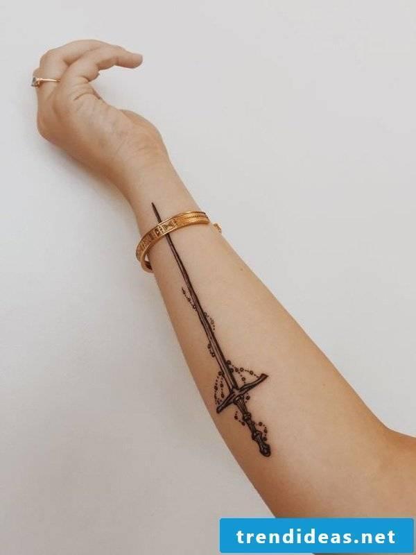 cool tattoo ideas women arm sword tattoo motifs tattoos women