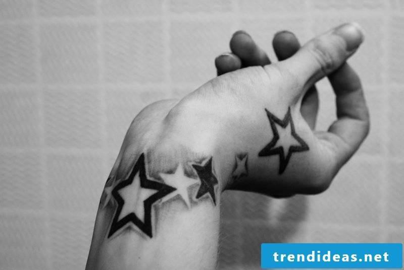 star tattoo ideas black forearm hand