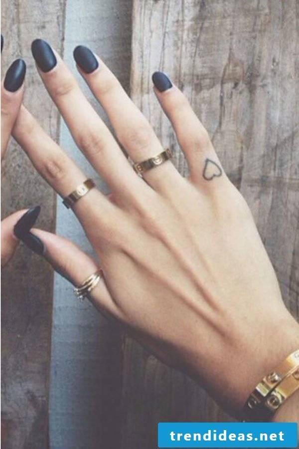 Heart tattoo motifs women tattoo ideas for women finger tattoos
