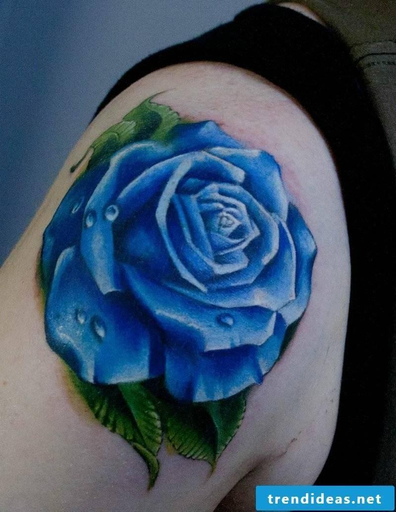 Tattoo on the shoulder blue rose
