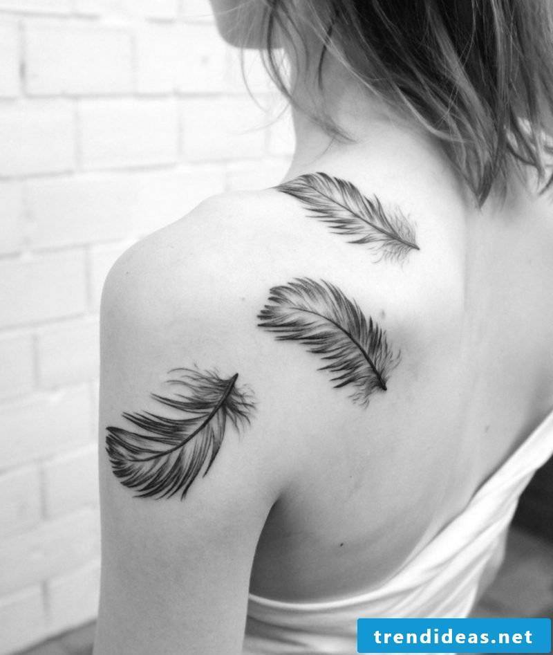 Tattoo with feathers on the back