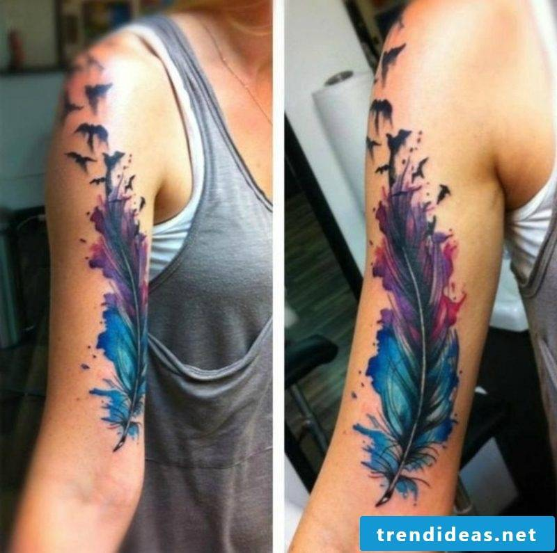 Feather tattoo upper arm water color