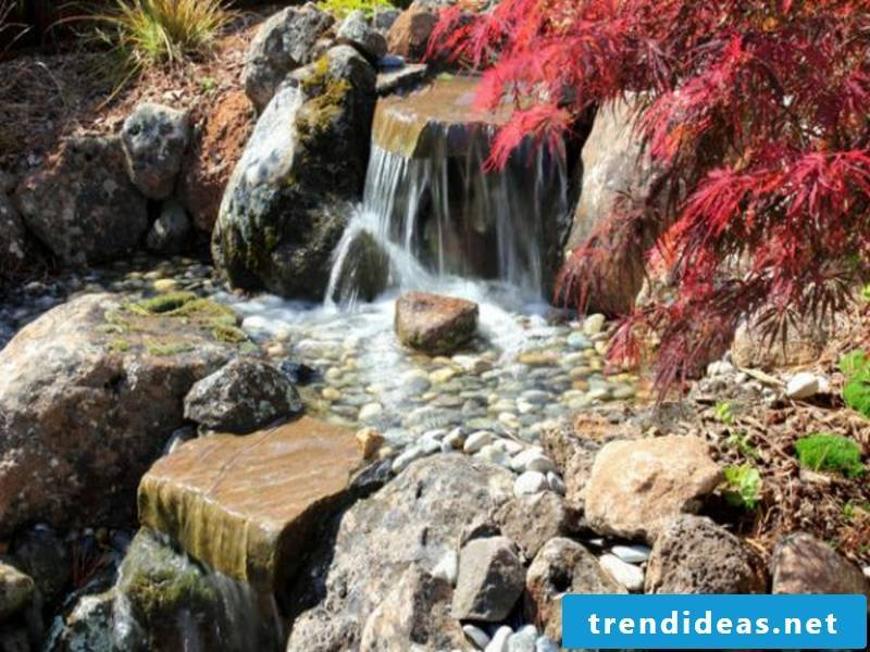 A Japanese garden with a waterfall