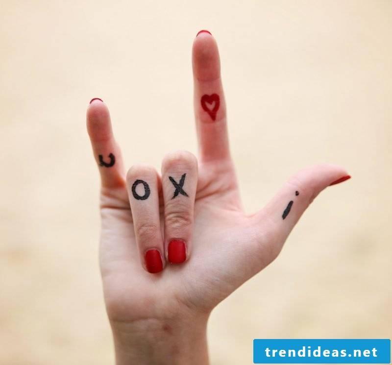 Finger tattoo love