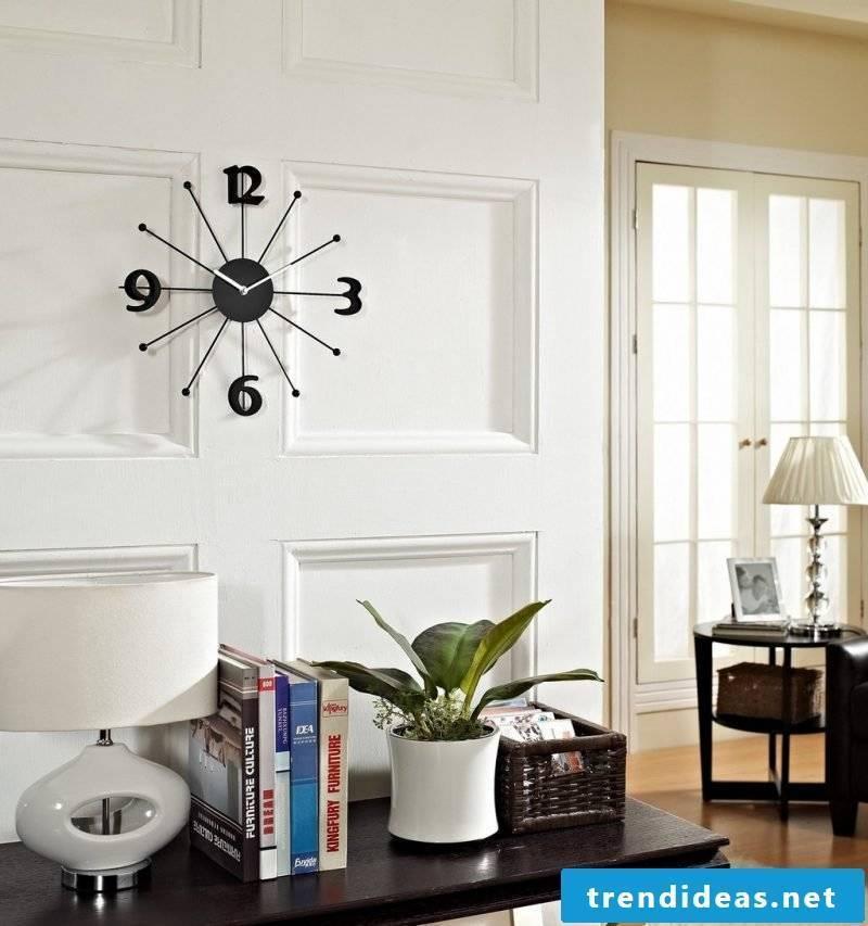 black wall clock decorating living room decorating apartment decorate