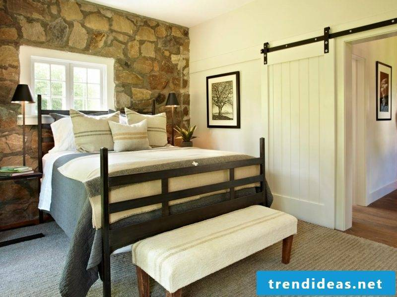 Wall panels with stone look for the wall with the bed
