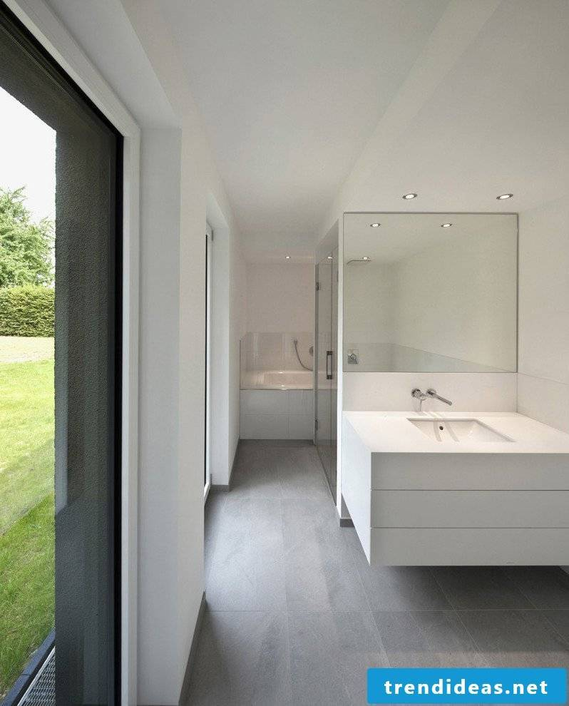With tiles in concrete look you create a large open bathroom with cool loft aesthetics
