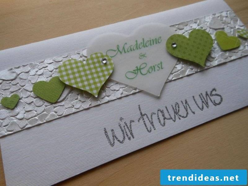 wedding cards tinker on white paper with green hearts