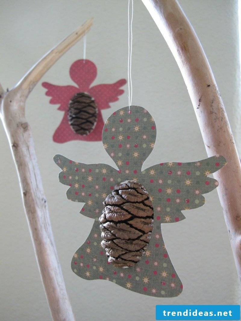Tinker with pine cones two angels