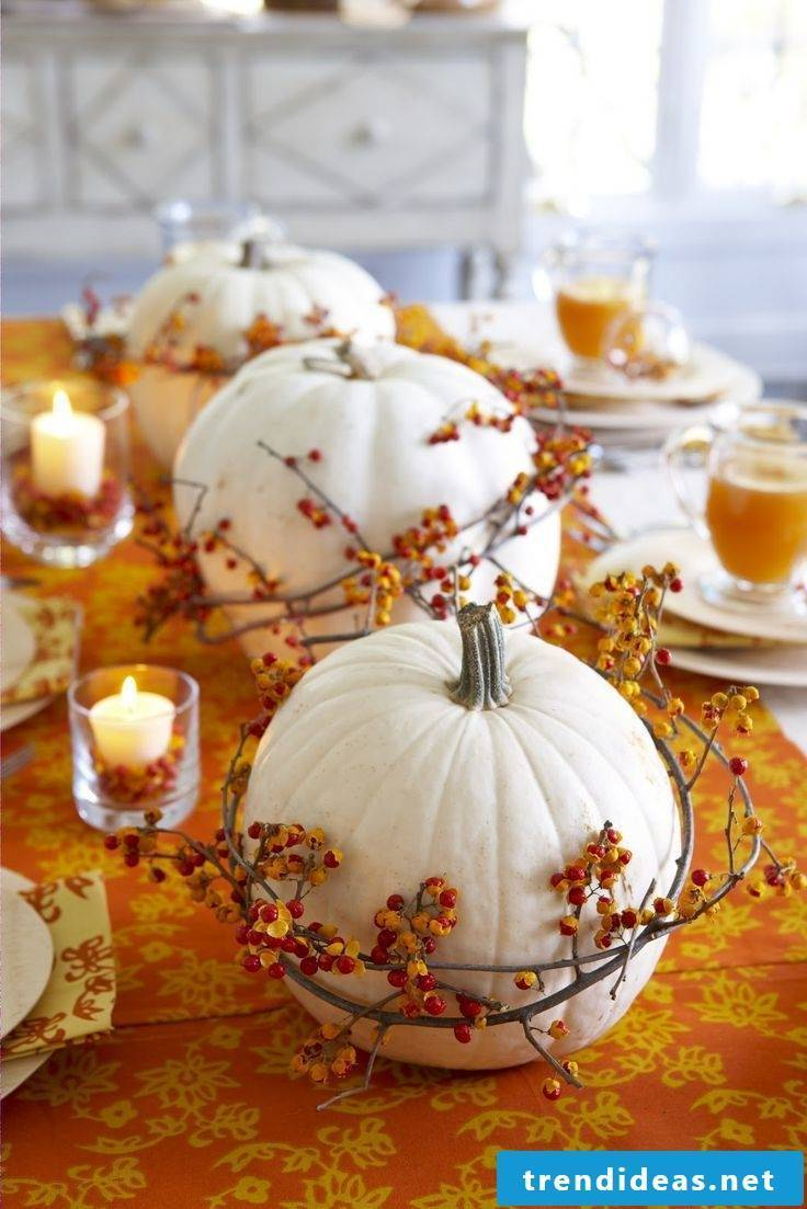 Decorate table with white pumpkins