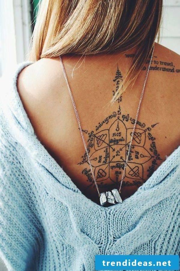 tattoo ideas women back tattoo writings